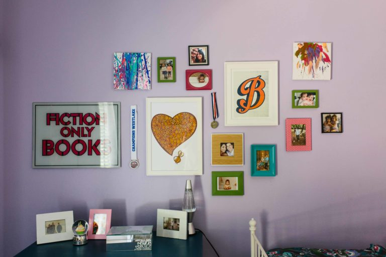 Kids room wall of frames in Austin, TX by BANDD DESIGN